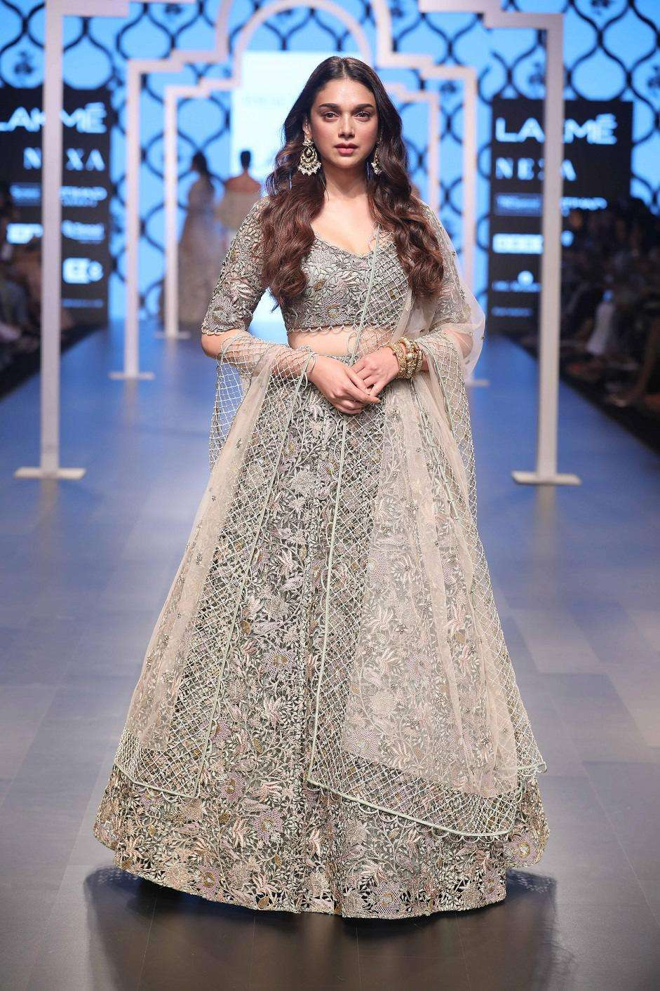 Image result for Payal Singhal collection 2018 | Hydari was seen on the ramp in a beautiful ivory silk, embroidered lehenga paired with a pretty net dupatta with a jaal border. #BridalLehengaGoals  | Lakme Fashion Week 2018 | Lakme Fashion Week | Show Stopper | Function Mania