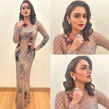 Actress Amruta khanvilkar wearing a gown by designer Nachiket barve and jewellery by Minawala Jewellers for the Marathi Filmfare Awards. Styled by Sayali vidya