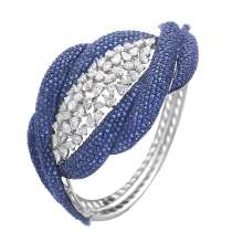 Cuff by ANMOL crafted in 18 K gold and set with blue sapphires and diamonds