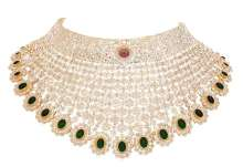18k gold Bridal choker studded with uncut diamonds along with emeralds and a ruby at the centre by Tanya Rastogi for Lala Jugal Kishore Jewellers